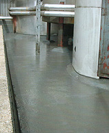 Resistant lining to bund containing heated aggresive chemicals.